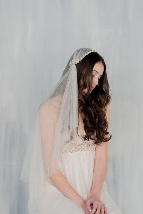Soft and Ethereal, we just cherish this gorgeous veil. Beautiful Double Layers of soft ultra drapey Irish tulle falls gracefully. The first layer falls to the elbow and can be worn as a blusher. The second layer falls gracefully to the floor. Beautiful Mokuba lace is hand stitched to the cap of the veil and completely encrusted with Preciosa crystals and Swarovski pearls. Beautiful venice lace is stitched to both ends of the crystal lace and are completely beaded with Preciosa crystals and…