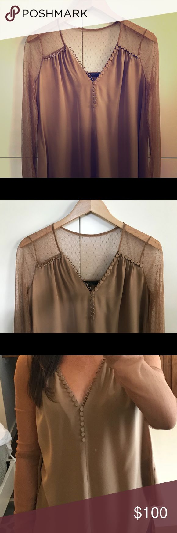BCBG Lace Sleeve Blouse Lace Sleeve, silk blouse. Loose, but flattering body skimming fit. Longer length. Deep v neck with button detailing. Looks great with jeans or polished leggings! XXS but runs on the larger side. BCBGMaxAzria Tops Blouses