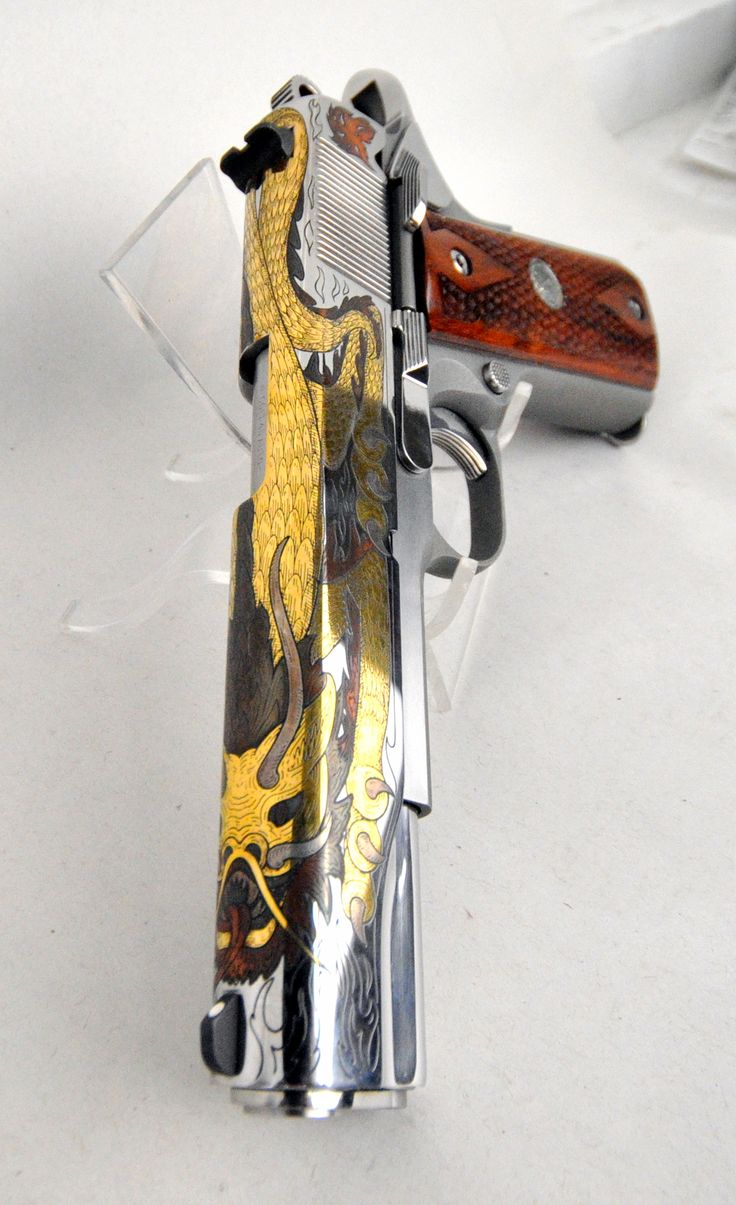 """Colt Limited Edition Silver Dragon Gov't Model 1911 .45 ACP 5"""" *NIB*. Model 01070XSEPII. Only 200 of these beauties were made, and this is # 006! Produced in 2004, this Colt custom limited edition is NEW in box & hard to find! It features a stainless steel receiver, and a bright stainless slide with a dragon, gorgeously etched in gold, copper, and nickel. The wood grips are textured to resemble dragon scales. 8+1 capacity of .45 ACP. 5"""" barrel. SOLD!"""