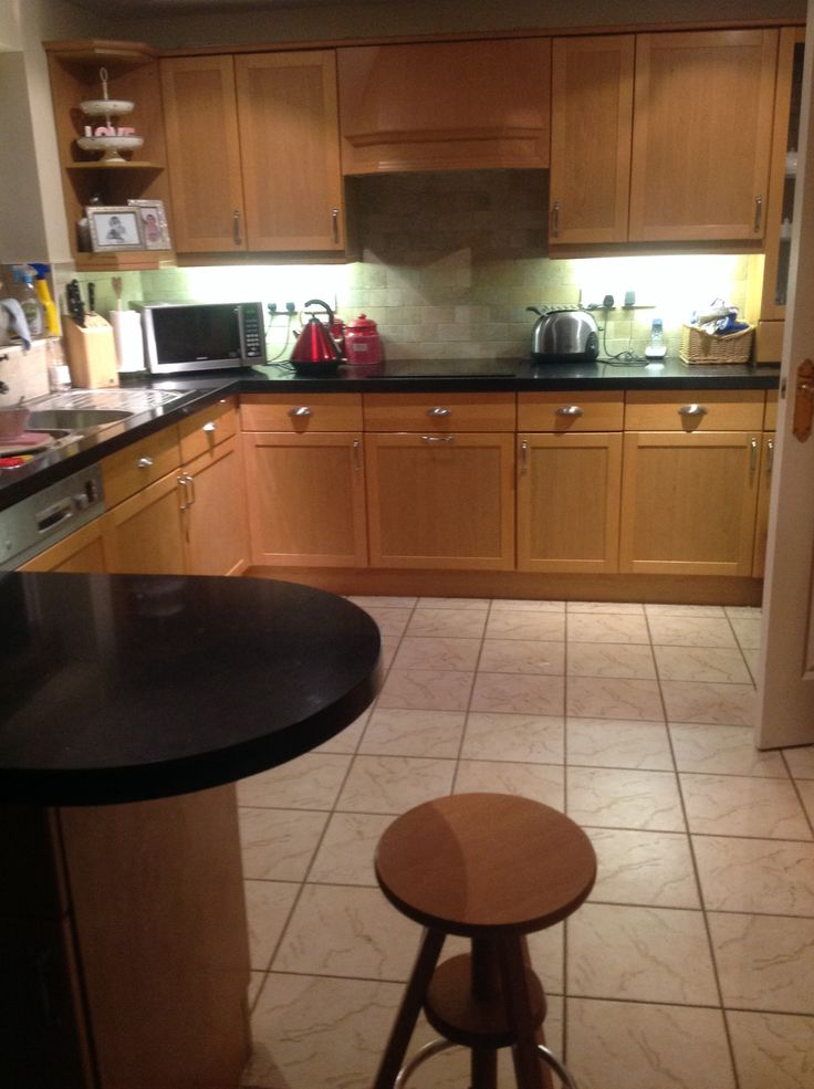 Granite transformations Nero kitchen worktop and stone effect tiles