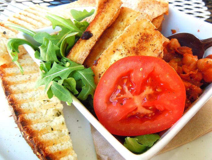 Tofu brunch!  Grilled tofu on vegan chili with arugula, tomato and grilled homemade focaccia at Niche cafe on Queen West in Toronto.