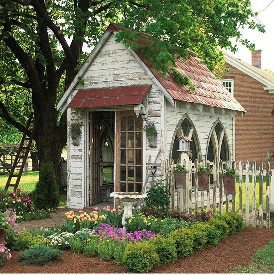 Oh My Word!  LOOK at THIS!  It stole my heart at first sight...right down to the picket fence and ladder in a nearby tree....I want it all....The ultimate play house for little girls and big girls and grandmas and gardeners!