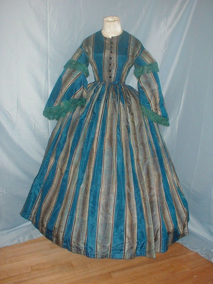 A stunning antique original 1860 royal blue, aqua and brown stripe silk dress that was once worn by Celine Prentice. The bodice has full pagoda styled sleeves. The sleeves are trimmed with blue silk fringe. | eBay!