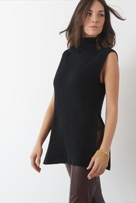 So on trend- shop this sleeveless mock turtle neck before it sells out fast