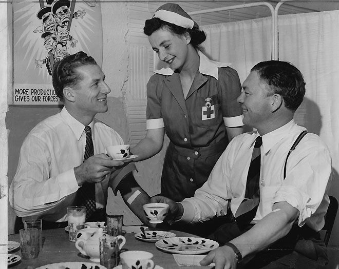 Packers receiver Don Hutson and Coach Curly Lambeau have refreshments after donating blood at the Red Cross plasma center in a photo dated Dec. 8, 1942, the day after the Packers defeated the Steelers.