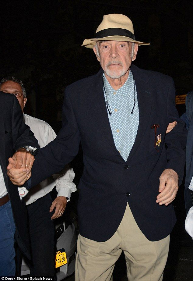 Sean Connery 15.9.2015 Make way: The legendary star was being supported by helpers as he left the venue...
