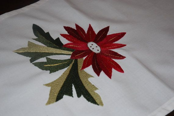 Wonderful Christmas table runner, embroidered carefully by hand, Alexandrine flower, on cotton/linen fabric.  Ideal for Christmas table or New Year's Eve table. An excellent gift for weddings. It can instantly add color to your table, serve as the perfect holiday runner.   Excellent quality, made with care and special technique. Dimensions are 125 X 33.  Machine washable.  If you would like any specific dimensions, further quantity, another design/pattern, I will be happy to prepare...