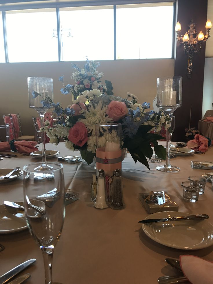 A creative beach themed centerpiece for Chelsey and Charles' wedding at White Clay Creek Country Club.
