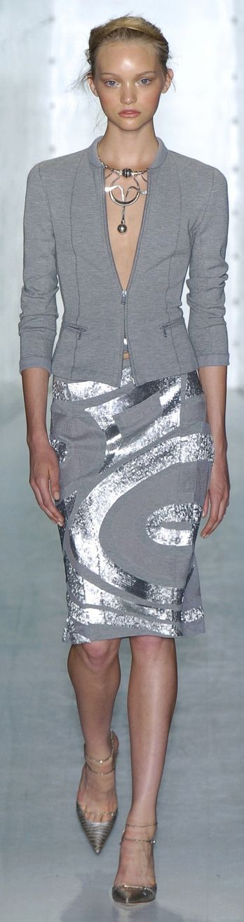 Donna Karan. Love it! Strong, chic look and the pieces are easily worn separately.