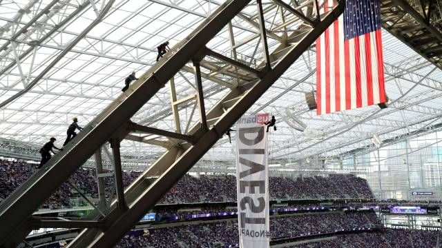 Two Dakota Access Pipeline protesters scaled the indoor heights of U.S. Bank Stadium during Vikings game