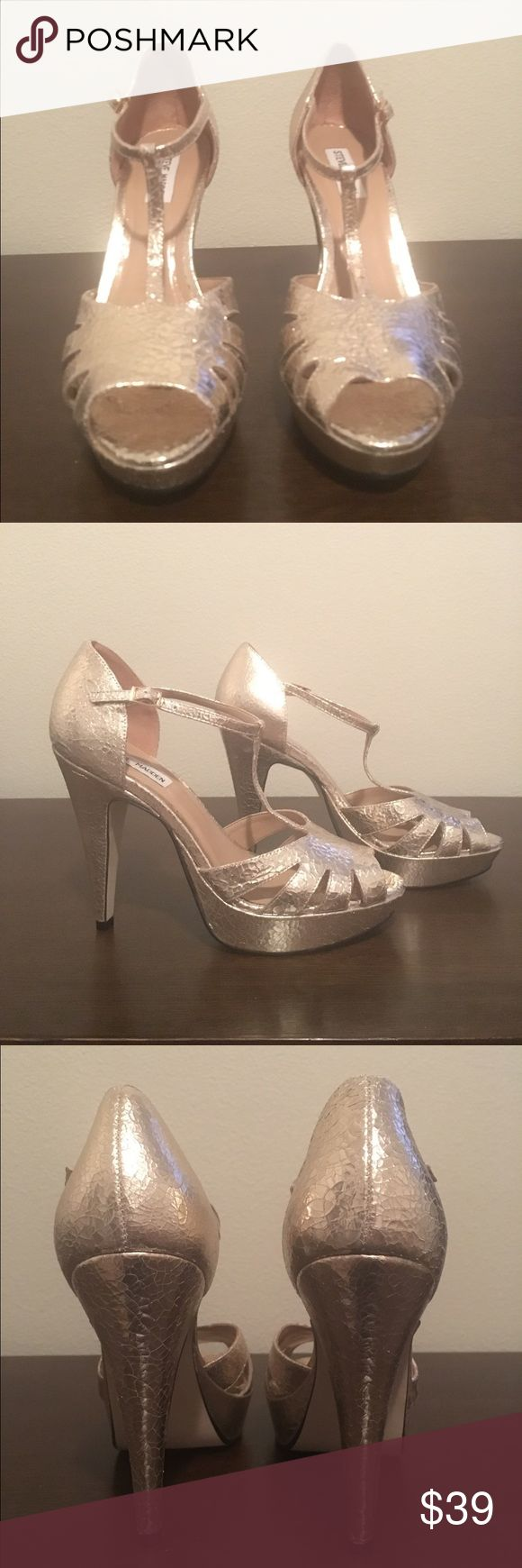 Platform open toe heels Steve Madden metallic gold open toe pumps. Never worn but the heels do have slight scratches. Not very noticeable refer to pictures. Heel height 4.75 inches with 1 inch platform  No box Steve Madden Shoes Heels