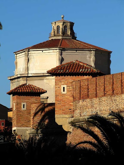 """Turrets of the """"Fortezza Nuova"""" with the octagonal dome of the church of Santa Caterina in background"""