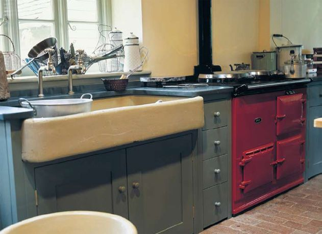 love the large sink and red Aga in this scottish kitchen