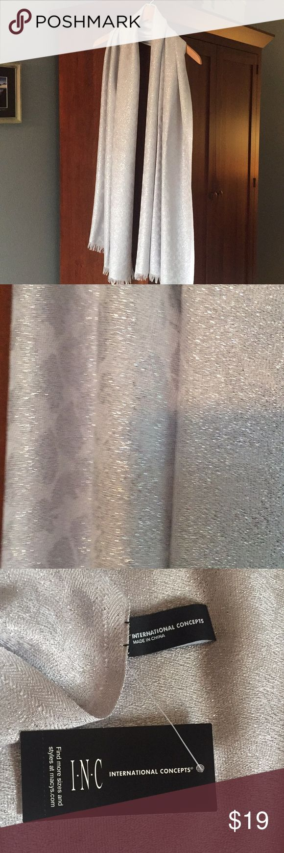 New light silver wrap Beautiful new ( never worn) silver light wrap. Approximately 80x29. Accessories Scarves & Wraps