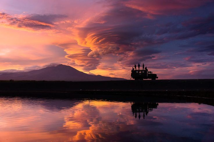There are a total of 160 volcanoes, 29 of which are still active in the Kamchatka Peninsula of far east Russia. On this night, incredible lenticular clouds formed amidst a glowing red sunset reminding us of a volcanic plume. If you visit this vast wild landscape you will feel a rawness that we rarely experience while traveling.