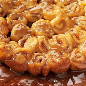 Mini Caramel Rolls Recipe -Here's the perfect warm treat for pajama-clad family mornings. These ooey-gooey baked rolls come together in moments—thanks to a tube of refrigerated crescent rolls—and disappear just as quickly. —Kayla Wiegand, Congerville, Illinois