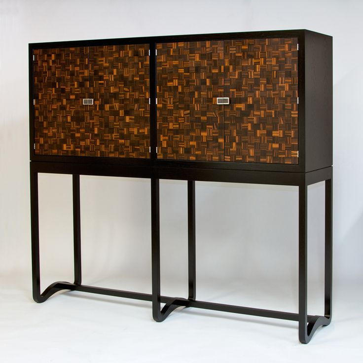 Here is my latest cabinet, made from Macassar Ebony and ebonised Oak, with handmade Nickel Silver handles.