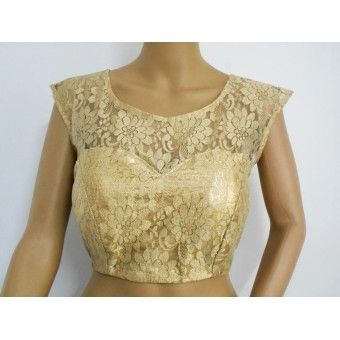 Floral pattern in gold lace - this gold designer blouse is a keeper for sure! Very attractive, very designer. The shoulder and sleeves are translucent to do justice to the gold lace, the lower part has a gold brocade lining and is padded with back hooks.