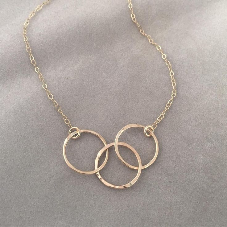 I love all things circles when it comes to jewelry. I LOVE the hammered metal and three intersecting circles. So simple and practical for everyday use.