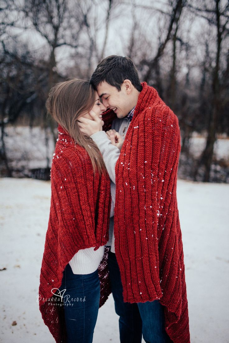 couple photoshoot in snow couple pose with blanket Brianna Record Photography OKC