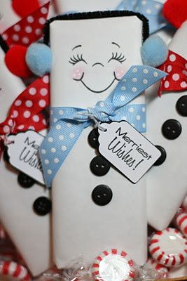 Wrapping chocolate bars in white paper to make snowman gifts for all your guests and double as decor.