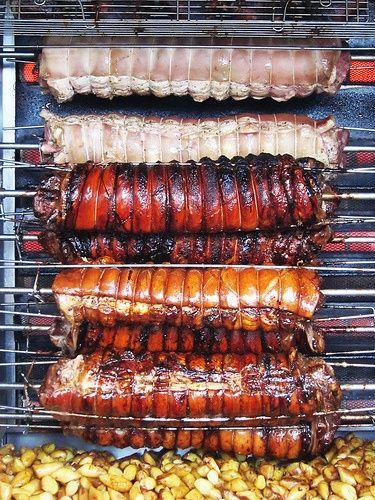 Beautiful pork loin roasting on a spit.