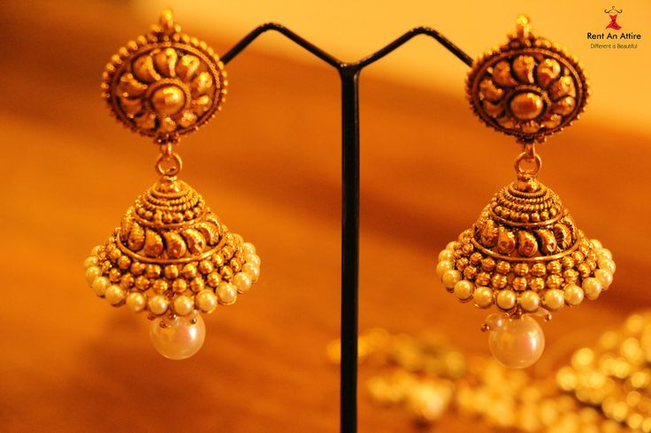 Simple traditional earrings suitable for the classiest of affairs, delicately shaped so as not to overpower, perfectly accents your beauty and taste. These gold and pearl earrings would perfectly match with any outfit.  Try it♡ Book it ♡ Flaunt it~ Rent an Attire #fashion #beauty #rentanattire #thejewelbox
