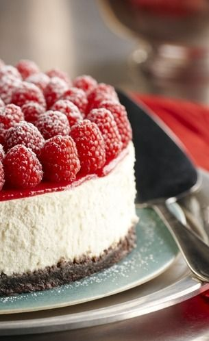 Raspberry Cheesecake ~ with Grand Marnier. Decadence in every bite. Elegant dessert that will wow your guests.