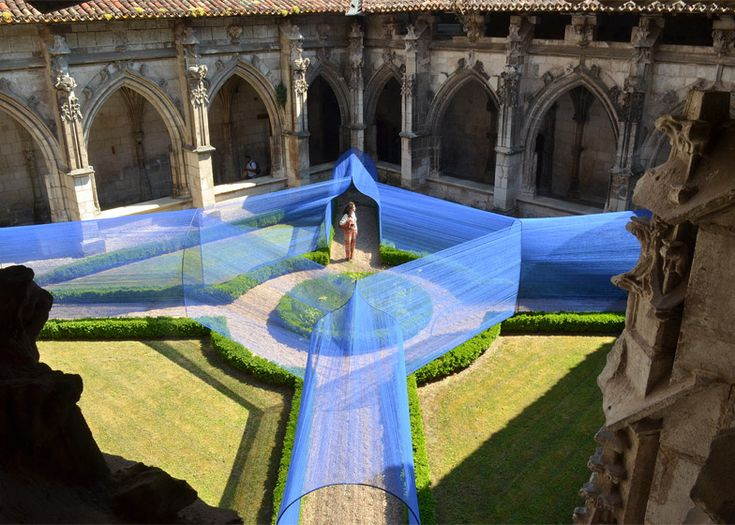 Vaulted string tunnels installed in a Gothic cloister garden.