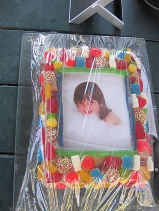 Photo frame cake for Ali's bday. Simple to make with a lolly frame created around a photo of the birthday girl.
