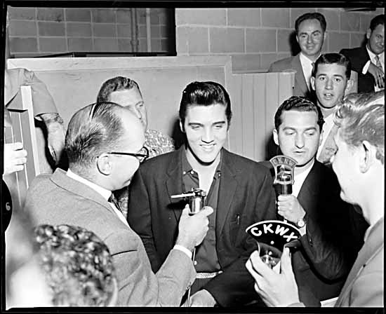 Elvis Presley with CKNW reporters VPL Accession Number: 61262 Date: 1957 Photographer / Studio: Province Newspaper