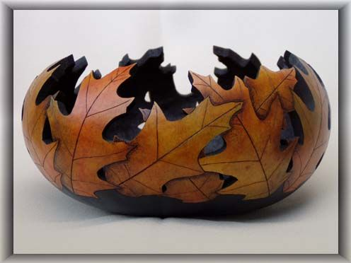 Oak Leaf Bowl | This bowl is made from a short canteen gourd that is relatively larger in diameter. The design is formed by pyrographed oak leaves, dyed with honey leather dye and rouged with oils in varied autumn tones. It is finished with acrylic varnish. Colors and details vary with each piece. $175