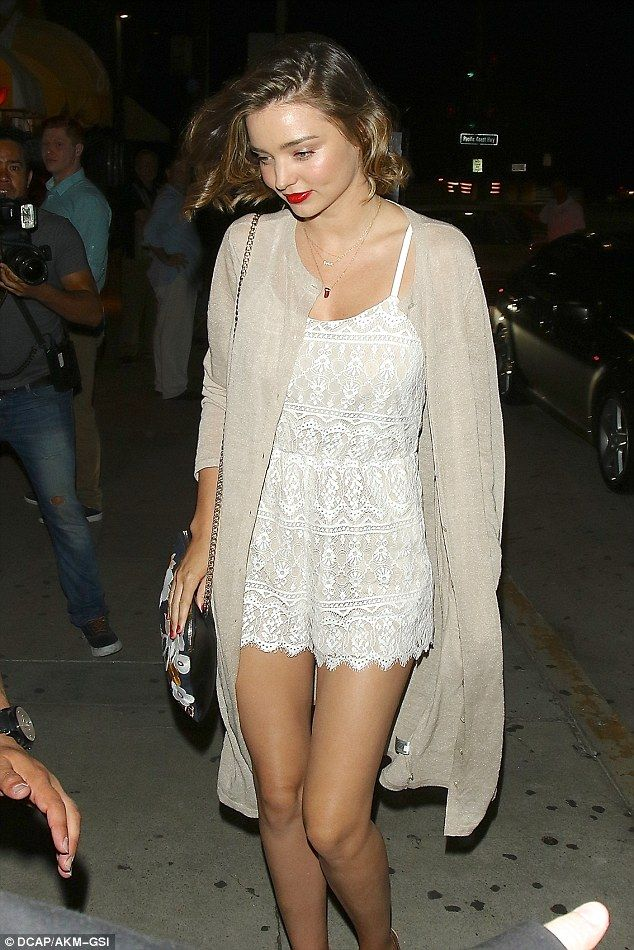 Glowing: Newly engaged Miranda Kerr, 33, looked incredible in a lace playsuit as she heade...