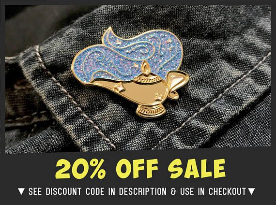 "20% OFF ALL ITEMS | MID YEAR SALE | Enter discount code ""DONUTS"" at checkout   #GenieLamp  Have genie by your side with this Aladdin inspired pin designed on our iPad. Size: 30mm Material : Glitter + Soft Enamel on Gold Plated Nickel ........................................ OR GET THE DISNEY THINGAMABOB SET: Checkout with Disney 3 set to recieve: 1x Cinderella Slipper Pin 1x Enchanted Rose Pin 1x Aladdin Lamp Pin  ....................................."