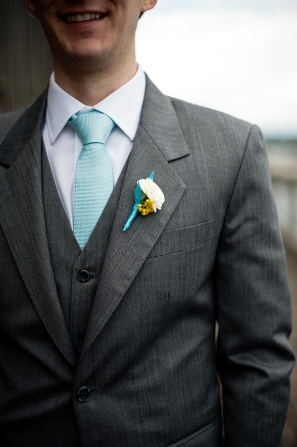 This robin's egg blue tie looks great with a gray suit!  The boutonniere is fun, too!