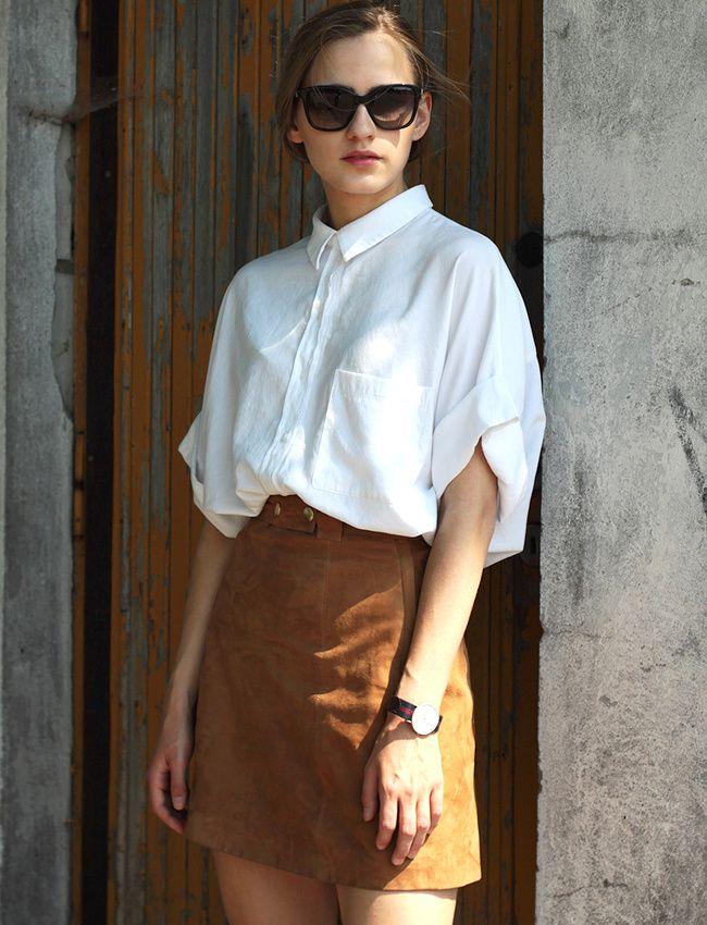 Ce printemps, on pense à faire blouser nos chemises oversize dans nos jupes trapèze taille haute