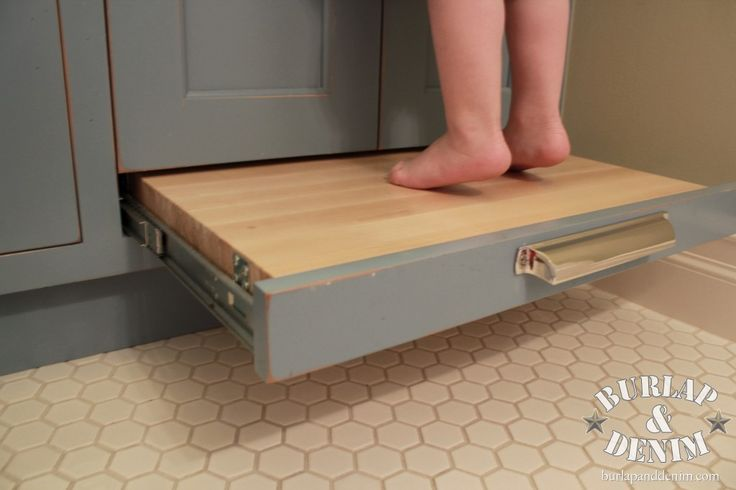 Built-In Vanity Step Stool - so the kiddos can safely reach the sink - Pottery Barn Inspired Kid's Bathroom - via Burlap and Denim