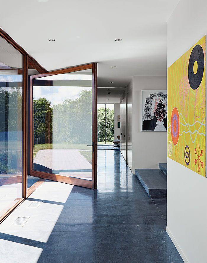 Polished concrete floor - El Topo pivot door and concrete floor.