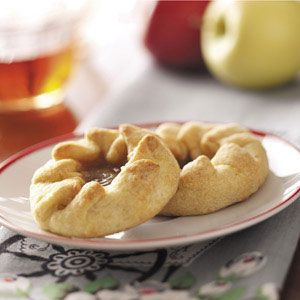 "Apple Pie Pastries from taste of home.  cut apples into 1/2 "" rings.  roll out 1.5"" balls of dough into 5"" circles.  place apple ring in it, sprinkle goodies over it,  fold edges of dough over apple slice."