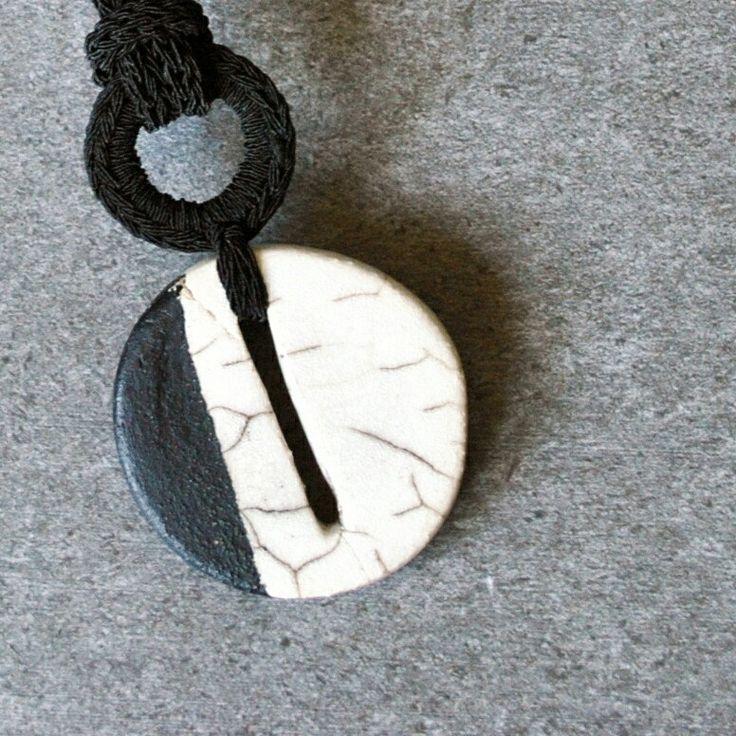 Circle raku ceramic pendant. Aliquid geometric necklaces.