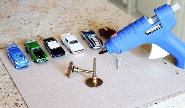 Cute Idea: Turn Hotwheel cars into drawer pulls. How to Add Some Car Flair to Your Kid's Room! | ModernMom.com