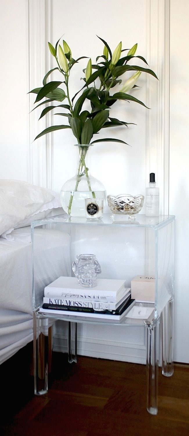 Bright White Bedroom With Acrylic Furniture Accents.
