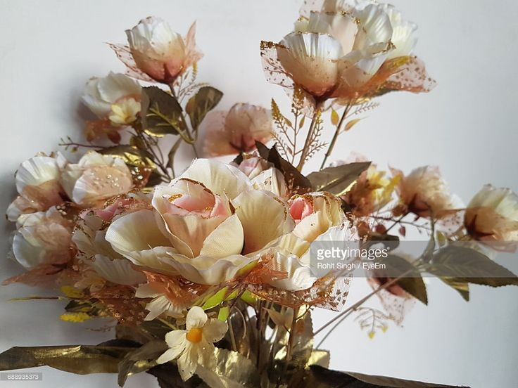 Stock-Foto : Close-Up Of Artificial Flower Bouquet Against Wall