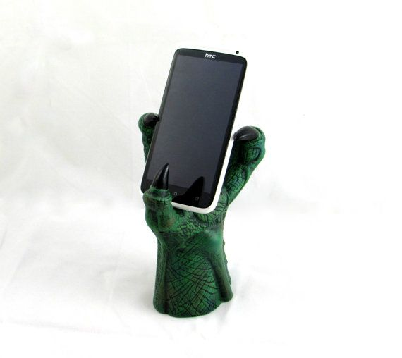 Ceramic hand painted dragon claw perfect for holding a cell phone and smart phone. Great for fantasy lovers and as a unique gift for friends and family with a taste for geeky fantasy! Hand-painted with assorted colours available, please specify if you have a colour preference. A matte finish is applied so that the piece can be cleaned easily with water or diluted cleaner. **Dimensions:  7 inches tall  2.75 inches wide at base    **This item is hand made from start to finish in my shop. We…
