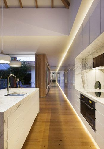 Like the way lighting all along the ceiling paralleling lighting at bottom of kitchen cabinet elongates.