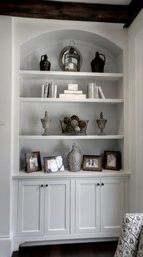 Idea for simple built-ins: combination of drywall with rounded edges and mdf shelves with door storage below to hide toys.