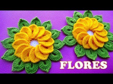 Flores tejidas a crochet de 12 pétalos con hojitas para tapetes y centros de mesa paso a paso - YouTube