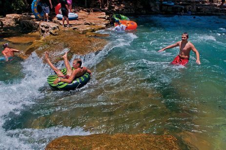 Water recreation in San Marcos includes tubing down the San Marcos River.