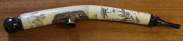 Antique Carved Oriental Opium Pipe with white metal burner. Lovely carvings, possibly Japanese along length of pipe. Unsure of material, but very possibly bone. Length measures 11 inches.