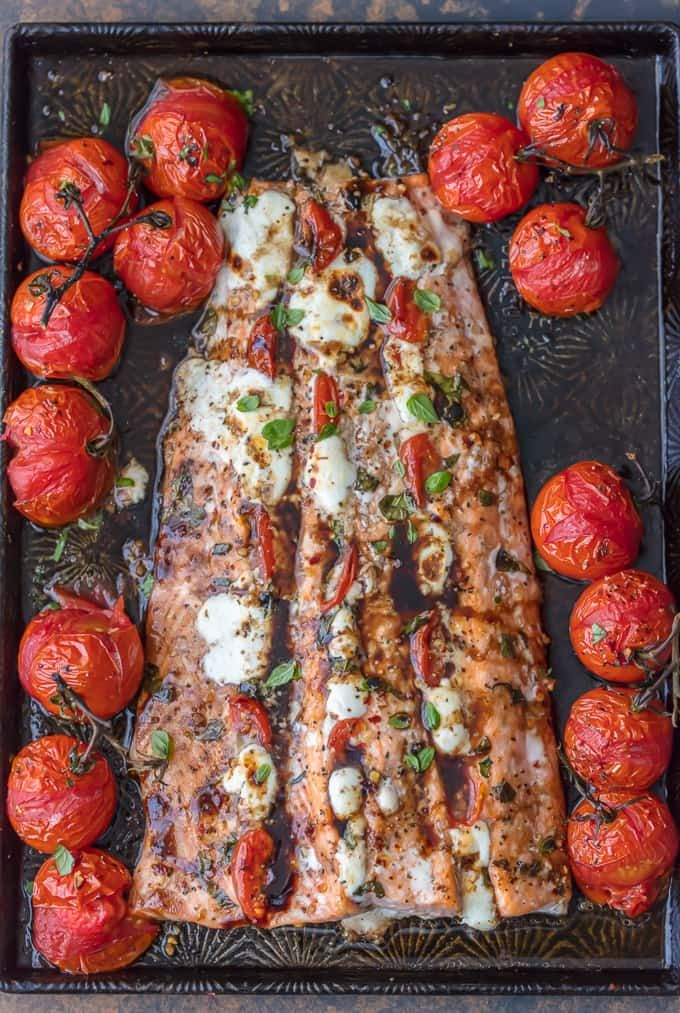 COOKBOOK PHOTOGRAPHER This CAPRESE STUFFED SALMON with BALSAMIC ROASTED TOMATOES will be your new favorite sheet pan dinner! This easy one dish salmon meal is loaded with flavor and oh so easy. Sure to please!
